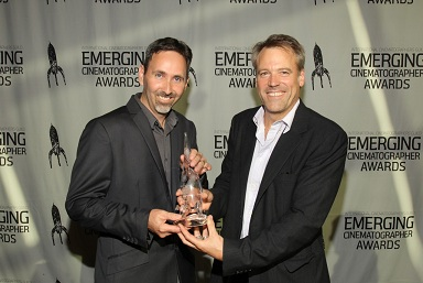Daron receives best cinematography at the International Cinematographer's guild Emerging Cinematographer Awards from Wally Pfister,ASC.